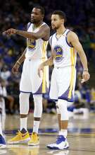 Golden State Warriors' Stephen Curry and Kevin Durant in 2nd quarter against Miami Heat during NBA game at Oracle Arena in Oakland, Calif., on Tuesday, January 10, 2017.