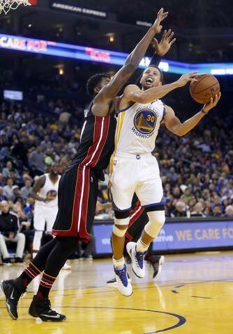 9bcadd37b6d7 Golden State Warriors  Stephen Curry is defended by Miami Heat s Hassan  Whiteside in 2nd quarter