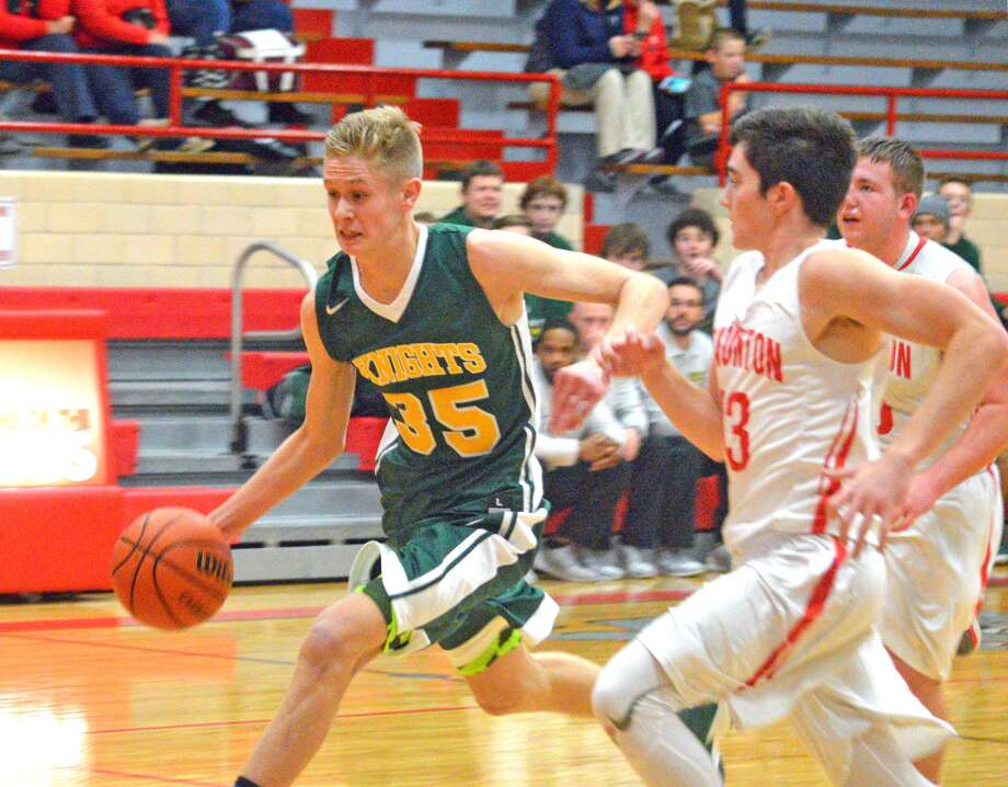 Metro-East Lutheran senior Noah Coddington drives to the basket during Tuesday's game at Staunton.