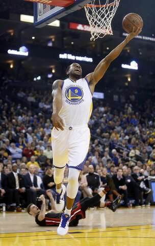 d884a792eeb3 Golden State Warriors  Andre Iguodala makes a lay up as Miami Heat s Tyler  Johnson is