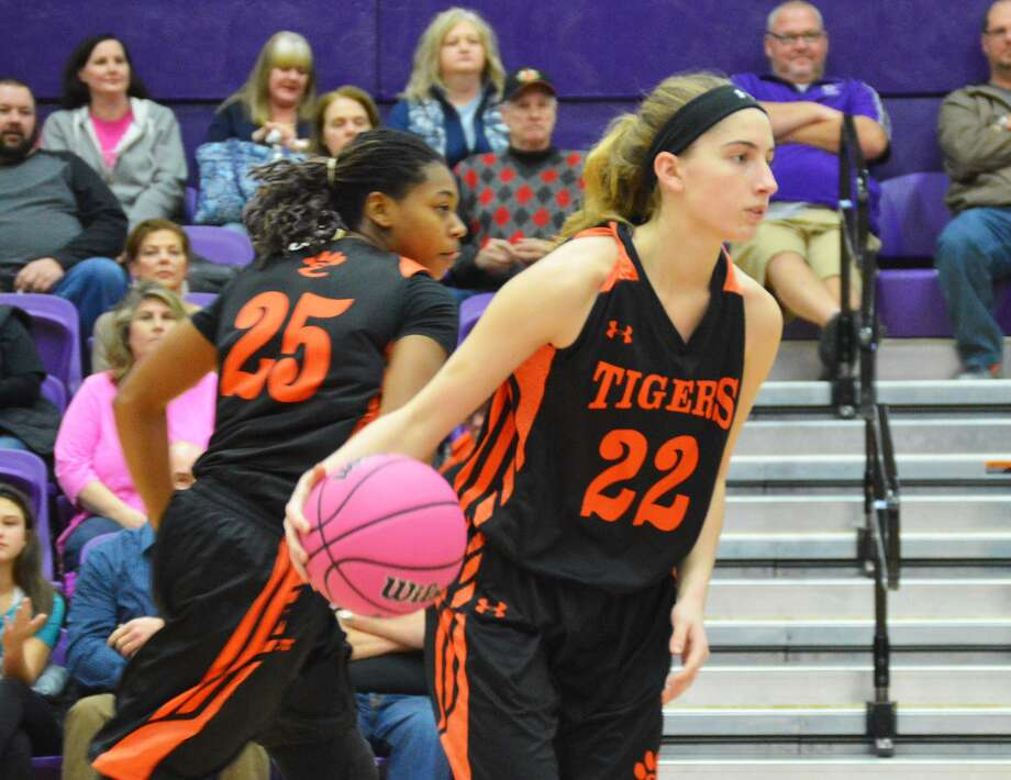 Edwardsville junior guard Kate Martin brings the ball up the court early in the first quarter on Tuesday against Collinsville at Vergil Fletcher Gymnasium.