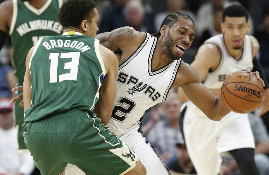 Kawhi Leonard gets fouled after coming up with a steal. Milwaukee's Malcolm Brogdon drew the personal on  Jan. 10 at the AT&T Center as the Bucks prevailed. Photo: Kin Man Hui /San Antonio Express-News / ©2017 San Antonio Express-News