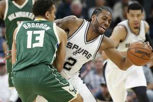 Kawhi Leonard gets fouled after coming up with a steal. Milwaukee's Malcolm Brogdon drew the personal on  Jan. 10 at the AT&T Center as the Bucks prevailed.