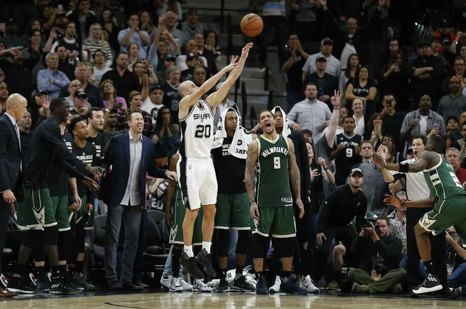 Spurs' Manu Ginobili (20) attempts a game-ending three-pointer as the Milwaukee Bucks bench reacts to the attempt at the AT&T Center on Tuesday, Jan. 10, 2017. The Bucks defeated the Spurs, 109-107.  (Kin Man Hui/San Antonio Express-News) Photo: Kin Man Hui, Staff / San Antonio Express-News / ©2017 San Antonio Express-News