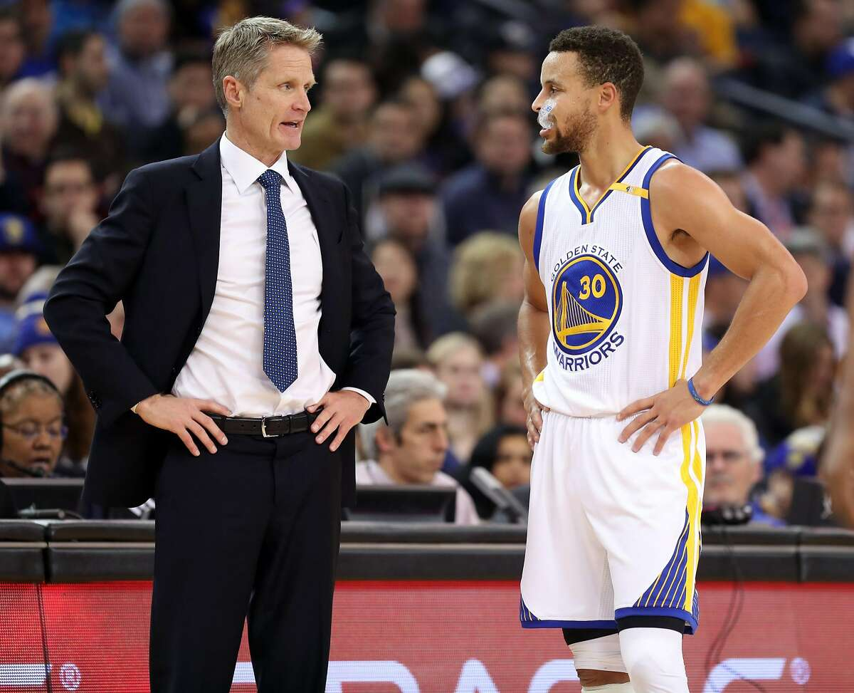Golden State Warriors' head coach Steve Kerr and Stephen Curry in 2nd quarter against Miami Heat during NBA game at Oracle Arena in Oakland, Calif., on Tuesday, January 10, 2017.