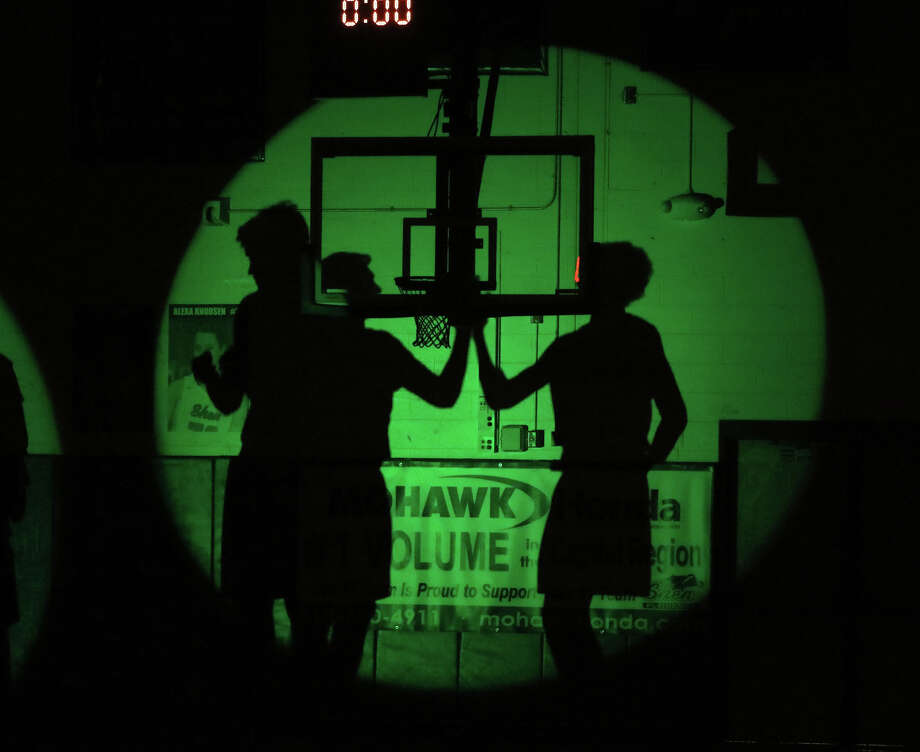 Green light silhouettes the Plainsmen as they prepare to take on the Patriots of Schenectady during Tuesday's Suburban Council matchup at Shenendehowa High School January 10, 2017. (Ed Burke-Special to the The Times Union)