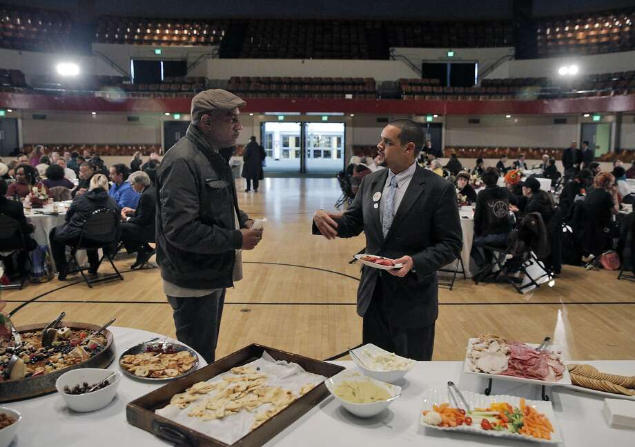 Melvin Willis (right) chats with Richard Boyd, of the Contra Costa Interfaith Supporting Community Organization, during a reception after the swearing in ceremony. Photo: Carlos Avila Gonzalez, The Chronicle