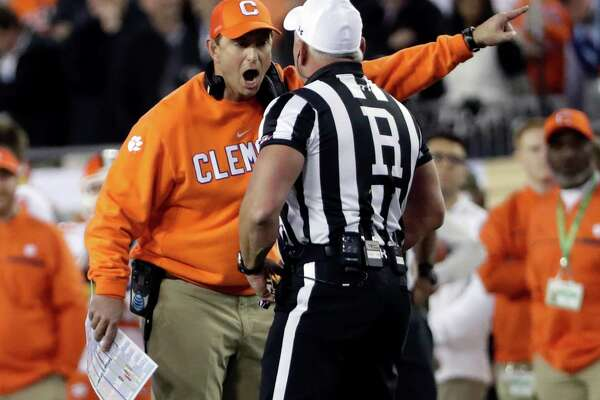 Clemson head coach Dabo Swinney argues a call during the first half of the NCAA college football playoff championship game against Alabama Monday, Jan. 9, 2017, in Tampa, Fla. (AP Photo/David J. Phillip)