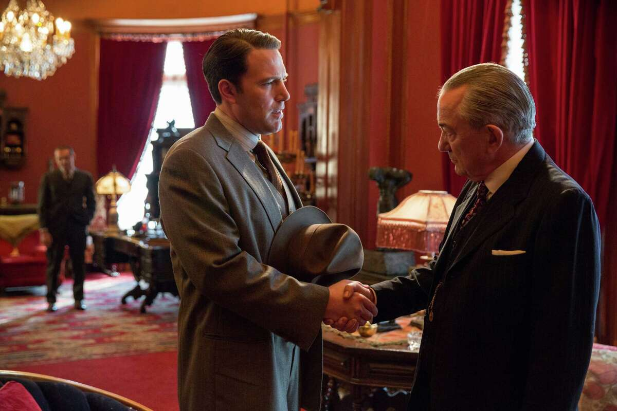 This image released by Warner Bros. Entertainment shows Ben Affleck, left, and Remo Girone in a scene from