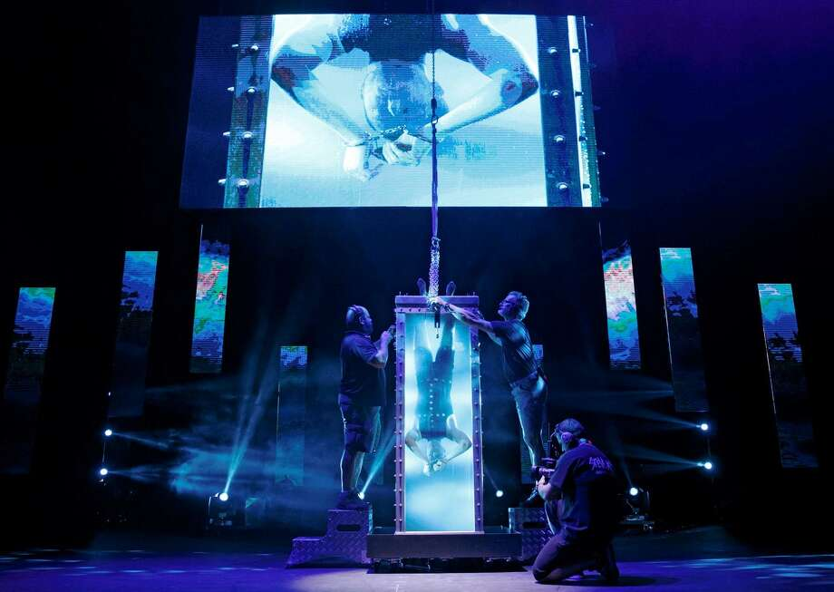 "Andrew Basso re-creates Houdini's water tank stunt in ""The Illusionists."" Photo: Courtesy Joan Marcus / ©2014, Joan Marcus"