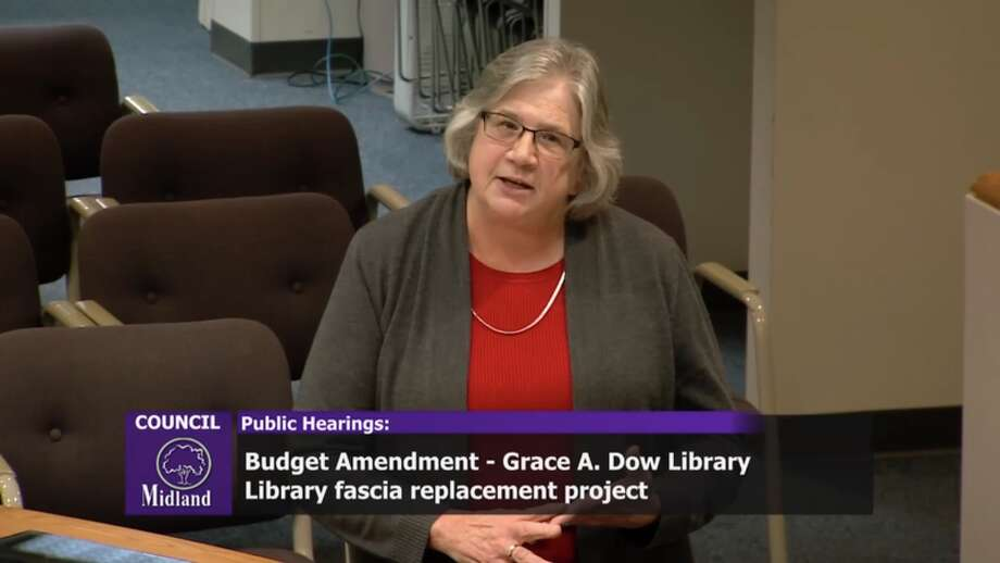 This screenshot of the televised Midland City Council meeting on Monday shows Grace A. Dow Memorial Library Director Melissa Barnard addressing council questions during a public hearing for the library's $440,000 fascia project.