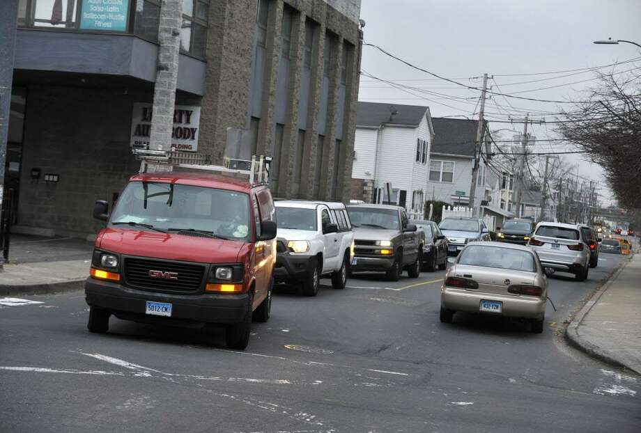 At the intersection of West Main Street and West Avenue, cars making left hand turns can hold up traffic. Photo: Michael Cummo / Hearst Connecticut Media / Stamford Advocate