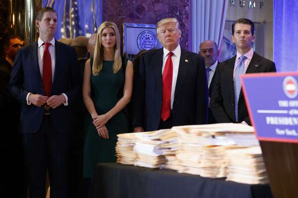 President-elect Donald Trump, accompanied by his family, arrives a news conference in the lobby of Trump Tower in New York, Wednesday, Jan. 11, 2017. (AP Photo/Evan Vucci)