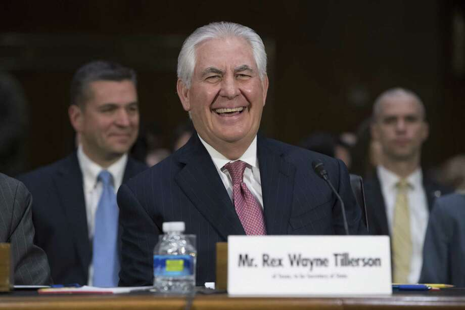 Secretary of State-designate Rex Tillerson testifies on Capitol Hill Wednesday at his confirmation hearing before the Senate Foreign Relations Committee. The exit package Exxon Mobil Corp. has agreed to pay Rex Tillerson if he's confirmed as secretary of state is structured to preserve roughly $180 million in deferred compensation for him — and might let him avoid an immediate federal income tax bill of as much as $72 million, according to tax specialists who have reviewed the plan. Photo: J. Scott Applewhite /Associated Press / AP