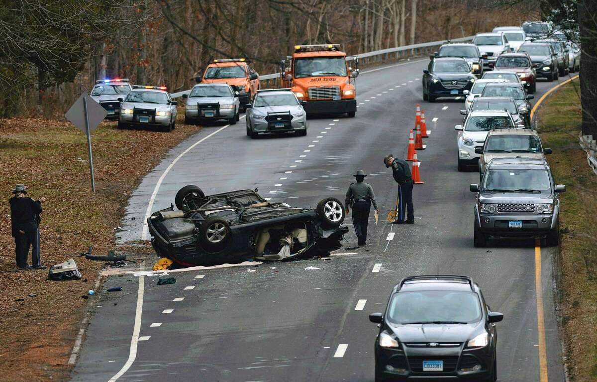 State Police investigate a serious rollover crash on the Merritt Parkway in Norwalk, Wednesday, Jan. 11, 2017.