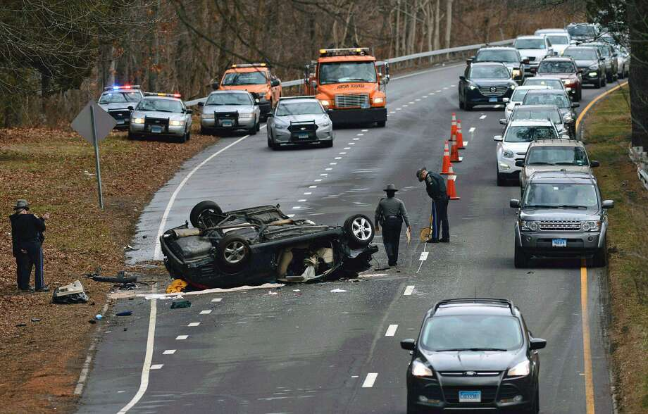 State Police investigate a serious rollover crash on the Merritt Parkway in Norwalk, Wednesday, Jan. 11, 2017. Photo: Eric Trautmann /Hearst Connecticut Media