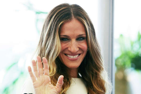 """Actress Sarah Jessica Parker attends the photocall of """"I Don't Know How She Does It"""" at the roof of Ritz Carlton hotel on August 29, 2011 in Moscow, Russia. (Photo by Kristina Nikishina/Epsilon/Getty Images)"""