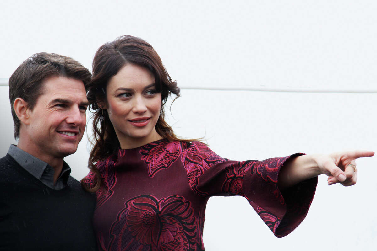 Olga Kurylenko and Tom Cruise attend a photo call of the 'Oblivion' at the Ritz Carlton Hotel on April 1, 2013 in Moscow, Russia. (Photo by Gennady Avramenko/Epsilon/Getty Images)