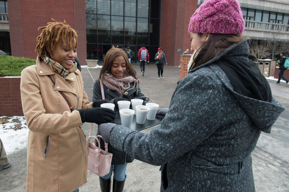 Students Leslie Hardin, left, and Taylor Sallis enjoy free hot chocolate from the SIUE Office of Student Affairs on the first day of spring classes. Photo: For The Intelligencer