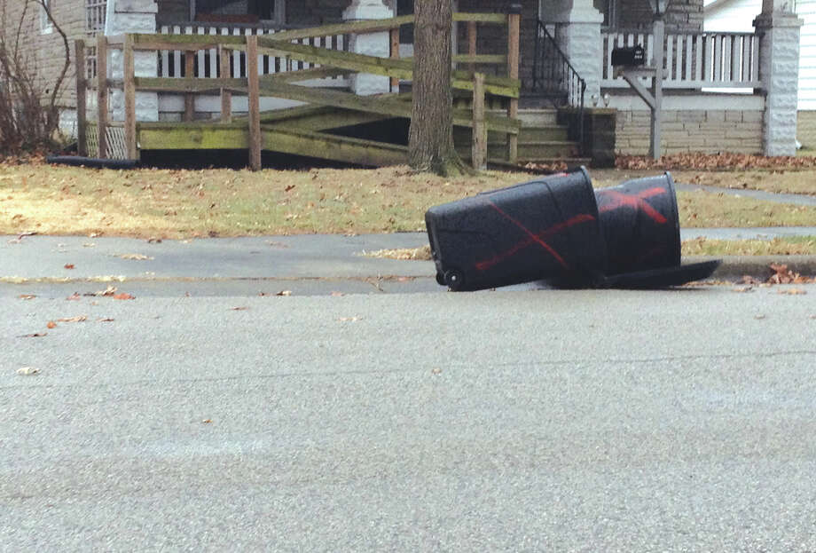 Tuesday's 35 mph wind gusts took their toll on these two upended yard waste containers on Madison Avenue. While the high climbed into the mid 50s on the thermometer, the wind took a bite out what were still welcome temperatures. Photo: Matt Winte • For The Intelligencer
