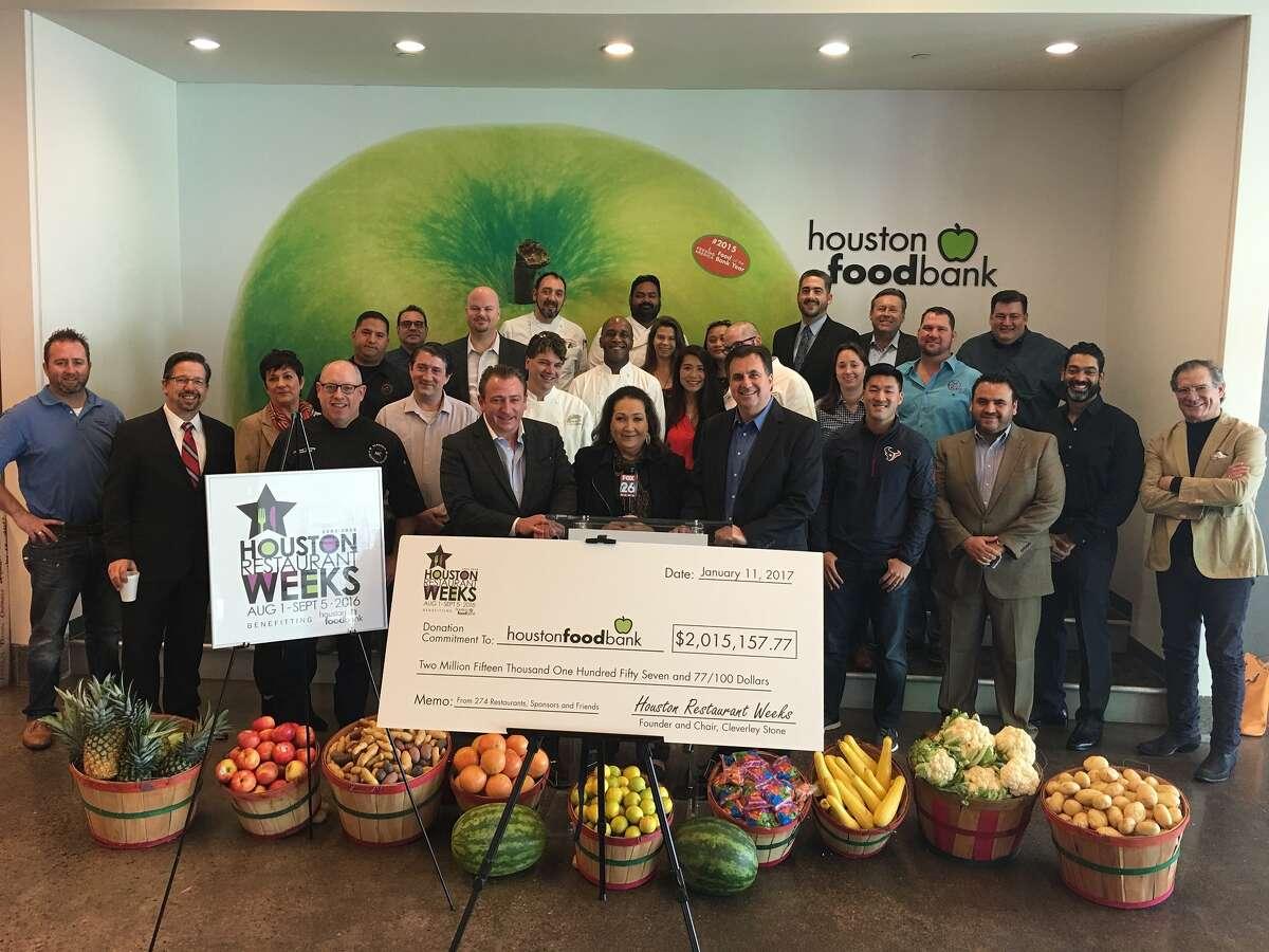 Cleverley Stone, center, the founder of Houston Restaurant Weeks, presented the Houston Food Bank with a record-setting $2 million donation collected during the 2016 fundraiser.