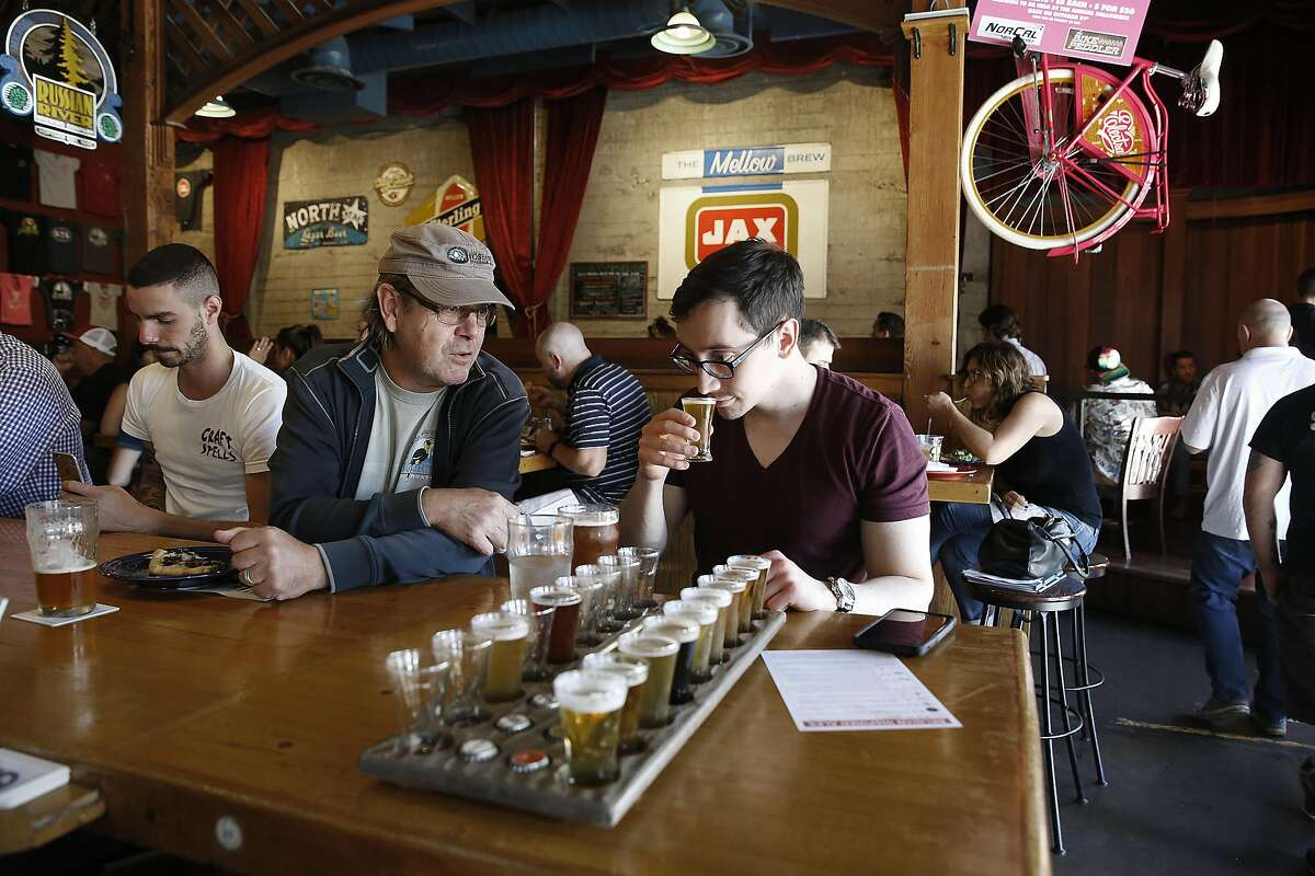 David Buchmueller (left) from Santa Rosa meets David Mendivil (right) visiting from Arizona as he tries a sampler tray at the Russian River Brewing Company brewpub in Santa Rosa, Calif., on Monday, October 26, 2015.