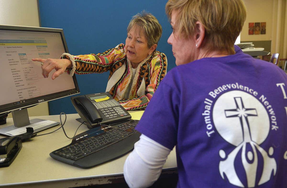 Becky Loving, from left, Tomball Emergency Assistance Miistries Director, and Susan Schaeper, Tomball Benevolence Network (TBN) Manager, go over their management system (GRACE), a new computer resource iCLoud program, at the TEAM ministry office in downtown Tomball on Jan. 10, 2017. (Photo by Jerry Baker/Freelance)
