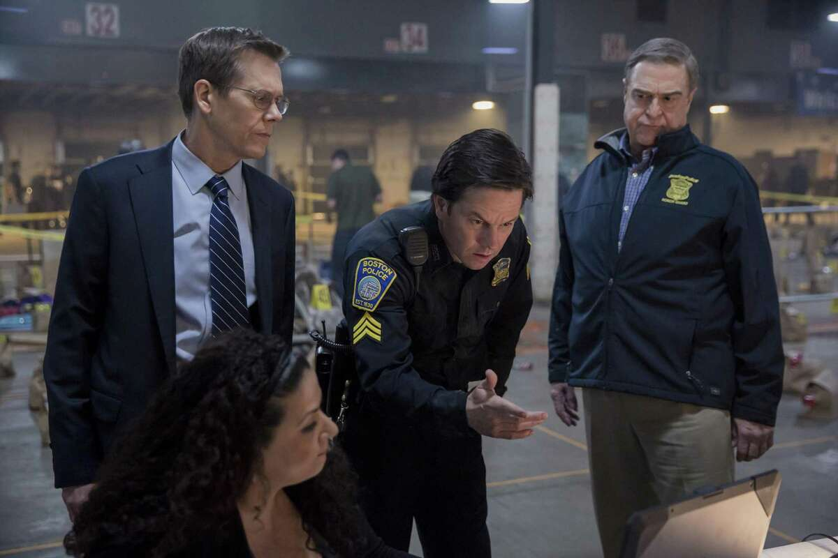 """Kevin Bacon (from left), Mark Wahlberg and John Goodman appear in a scene from """"Patriots Day."""""""