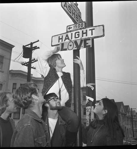Hippies add love to the Haight and Ashbury street signs. Photo: Photographer Unknown, The Chronicle