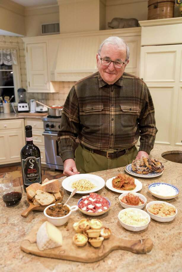 Anthony LoFrisco stands in his kitchen with dishes he made with his mother's recipes. Photo: Kyle Michael King / For Hearst Connecticut Media / Hearst Connecticut Media Group Freelance
