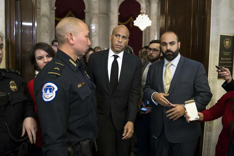 Sen. Cory Booker (center) warns that Jeff Sessions could move the country backward if confirmed as attorney general. Photo: Cliff Owen, Associated Press