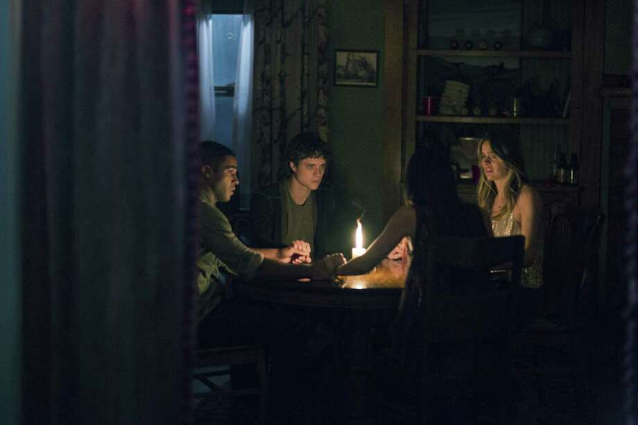 "Douglas Smith, Lucien Laviscount, Jenna Kanell and Cressida Bonas star in the horror film ""The Bye Bye Man."" Photo: STX Entertainment / TNS"