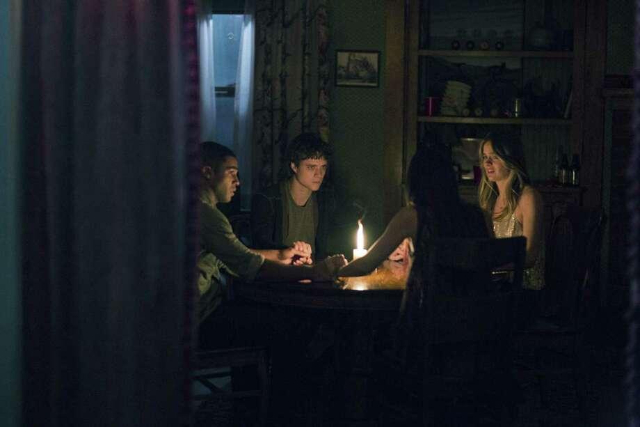 "Douglas Smith, Lucien Laviscount, Jenna Kanell and Cressida Bonas star in the horror film ""The Bye Bye Man."" Photo: STX Entertainment / TNS"