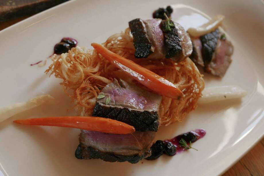 Duck on potato rosti at Signature. Photo: Billy Calzada /San Antonio Express-News / San Antonio Express-News