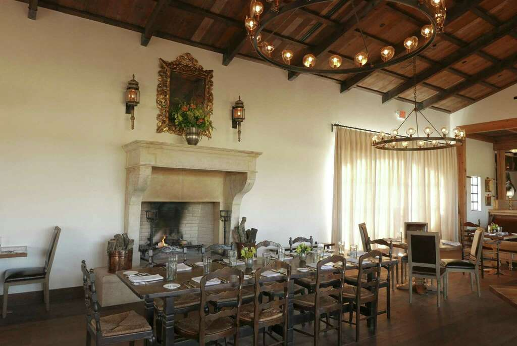 The Dining Room At Signature Is Warmed By A 15th Century Fireplace Imported  From France