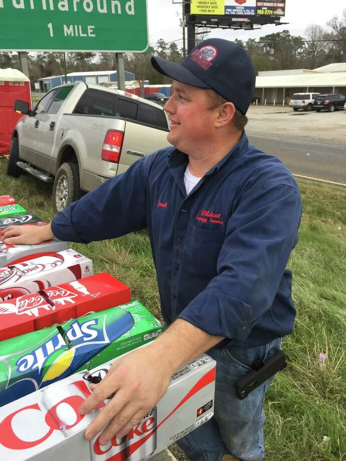 Jacob Conner, 37, took it upon himself to hand out free pizza and drinks during an I-10 wreck that shut down the highway for over five hours. Photo: Photos Courtesy Of Jill Skinner