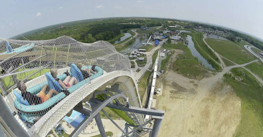 Riders slide down Verruckt, the world's tallest water slide, at the Schlitterbahn Kansas City Waterpark this summer. Schlitterbahn announced in November that it would permanently close Verruckt in light of the death of 10-year-old boy. Photo: John Sleezer /Kansas City Star / Kansas City Star