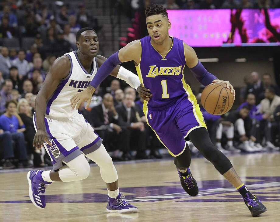 Los Angeles Lakers guard D'Angelo Russell drives against Kings guard Darren Collison during the first half on Dec. 12, 2016, in Sacramento, Calif. Photo: Rich Pedroncelli /Associated Press / Copyright 2016 The Associated Press. All rights reserved.