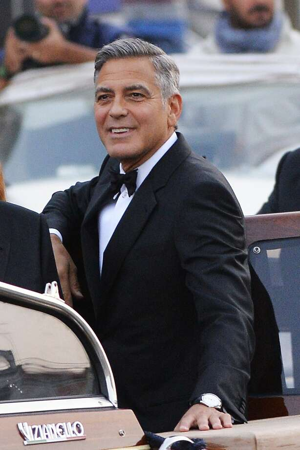 Actor George Clooney, wearing an Omega De Ville Tresor Master Co-Axial, arrives at the Aman hotel on Sept. 27, 2014, in Venice where Clooney and British fiancee, Amal Alamuddin, celebrated their wedding. Photo: ANDREAS SOLARO, AFP/Getty Images