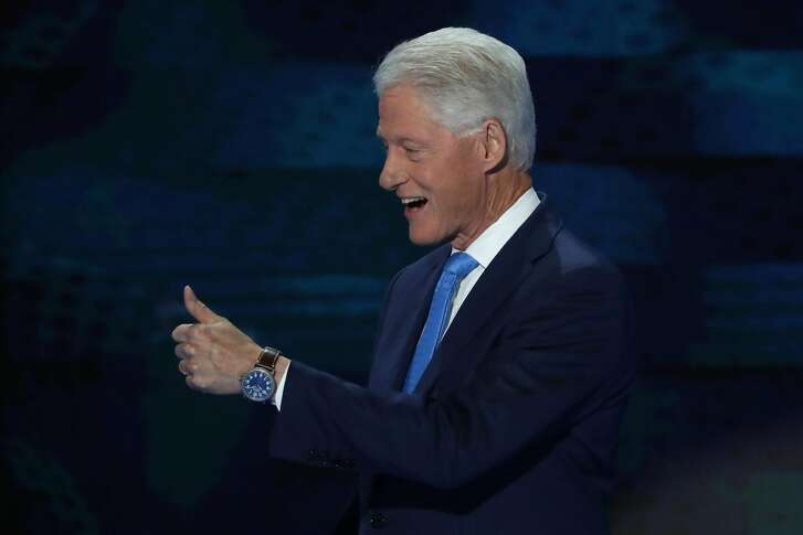 PHILADELPHIA, PA - JULY 26: Former US President Bill Clinton gives a thumbs up as he arrives on stage to deliver remarks on the second day of the Democratic National Convention at the Wells Fargo Center, July 26, 2016 in Philadelphia, Pennsylvania. Democratic presidential candidate Hillary Clinton received the number of votes needed to secure the party's nomination. An estimated 50,000 people are expected in Philadelphia, including hundreds of protesters and members of the media. The four-day Democratic National Convention kicked off July 25. (Photo by Alex Wong/Getty Images)