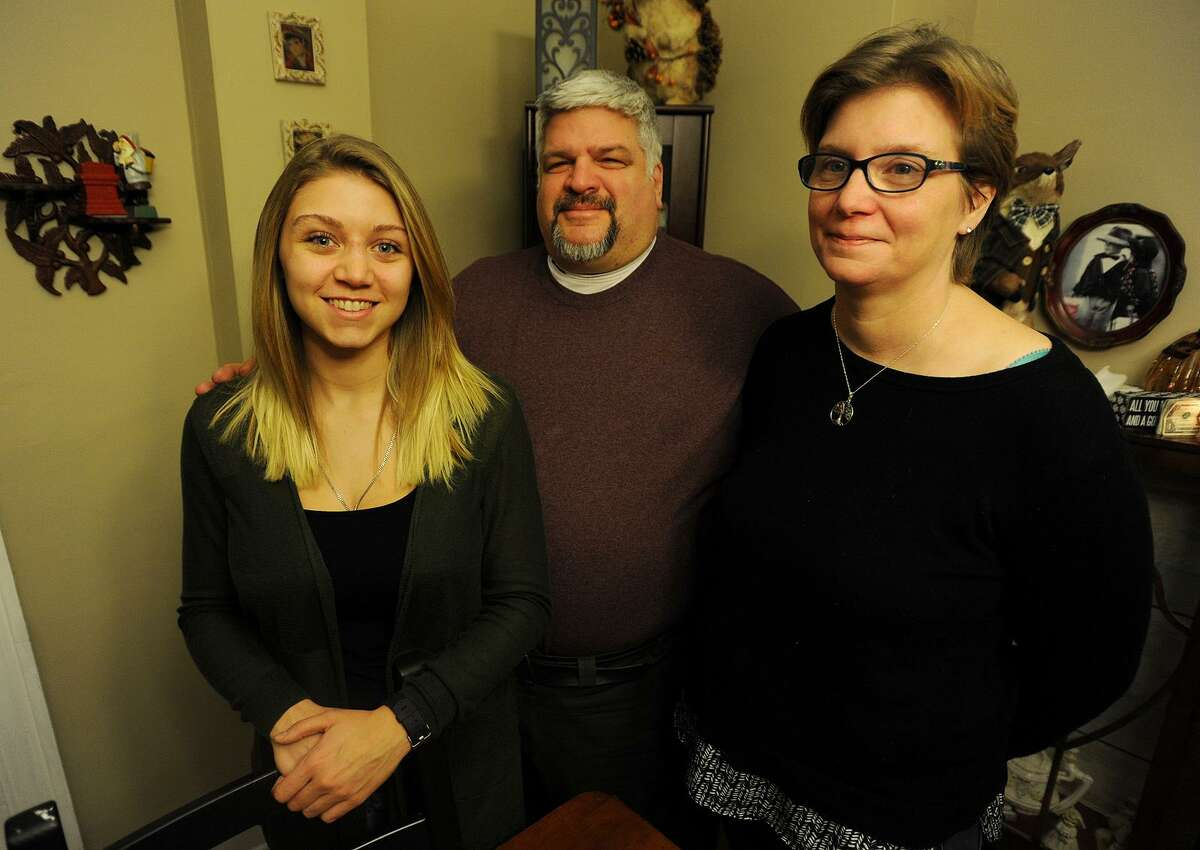 Alexandra Pisco, 23, and her parents Rich and Wendy DiCarlo at their home in Derby, Conn. on Monday, January 9, 2017. Pisco, who graduated two years ago from the University of Bridgeport, plans to pursue a career as a police officer.