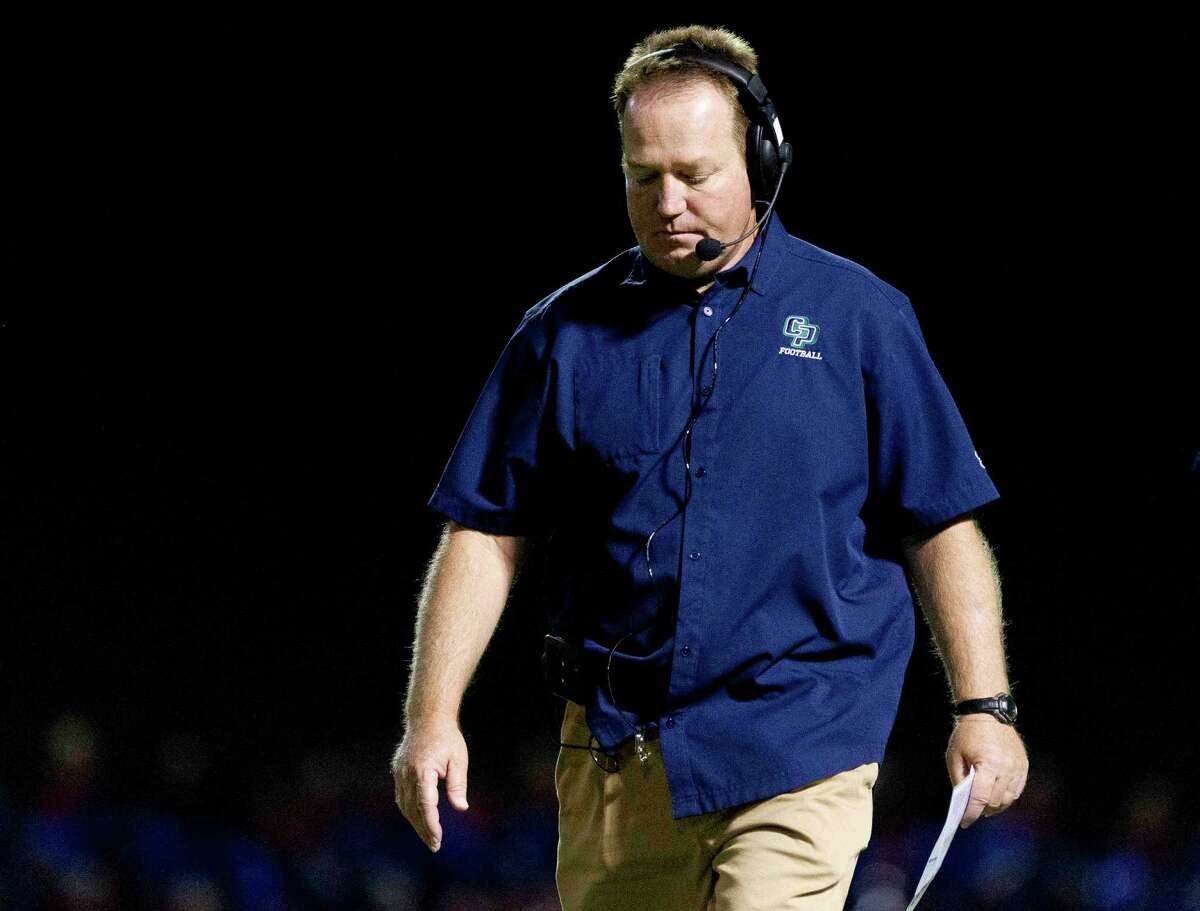 College Park head coach Richard Carson walks back to the sideline after a timeout during the second quarter of a District 12-6A high school football game Friday, Sept. 30, 2016, in Conroe.