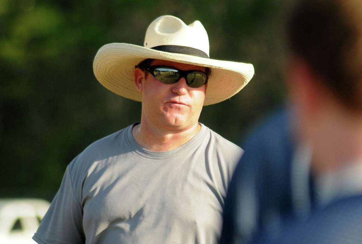 Head coach Richard Carson watches a play during the College Park High School football practice. Photo by David Hopper