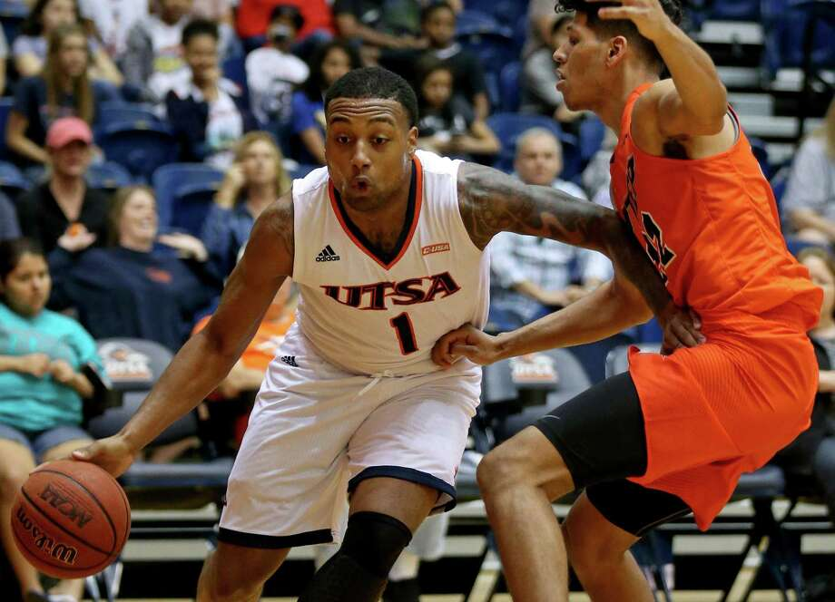 UTSA's Jeff Beverly drives around UTEP's Paul Thomas during second half action on Jan. 1, 2017 at the Convocation Center. UTSA won 67-55. Photo: Edward A. Ornelas /San Antonio Express-News / © 2017 San Antonio Express-News