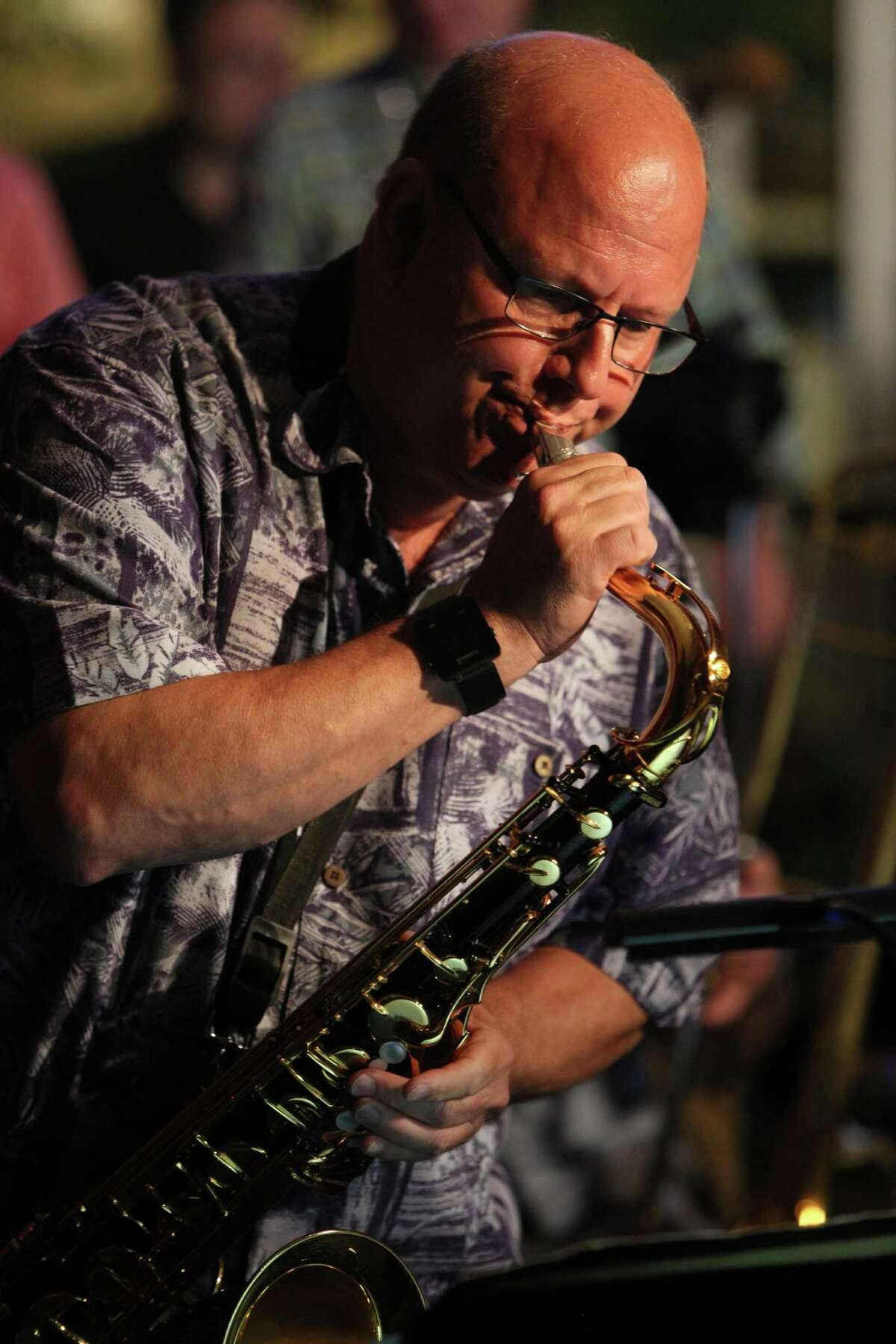 Stamford, Ct. 6.20.16 --- Ninth Note Jazz Supper Club --- Ken Nigro of Waterbury, playing a saxaphone solo adjusts his horn during the performance during a recent Monday session.