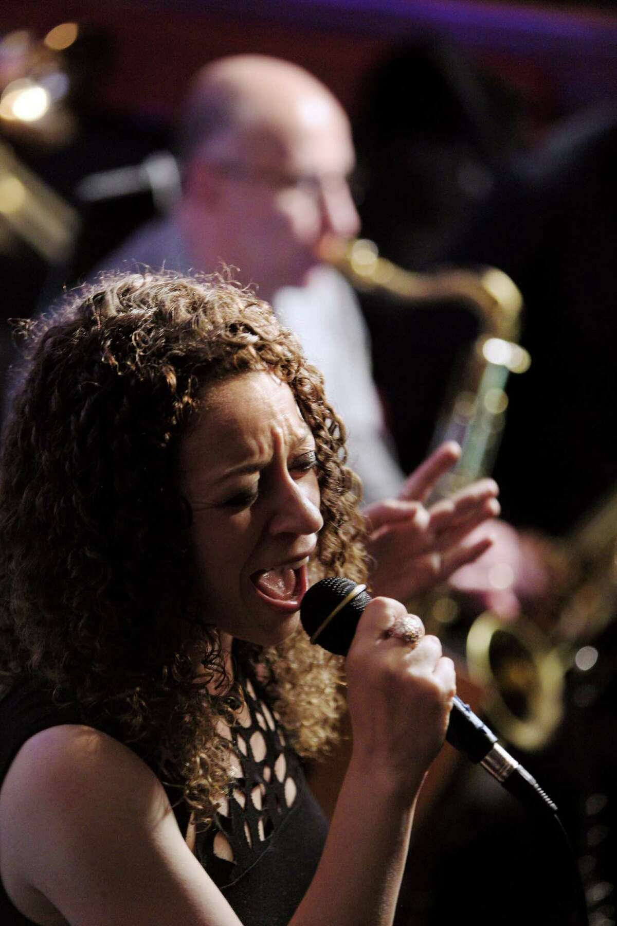 """Stamford, Ct. 6.20.16 --- Ninth Note Jazz Supper Club --- Jazz Singer Stephanie Harrison of Stamford joins the 9th Note Jazz Orchestra Monday evening and belts out a rendition of """"Natural Woman,"""" much to the amazement of the crowd and the Big Band."""