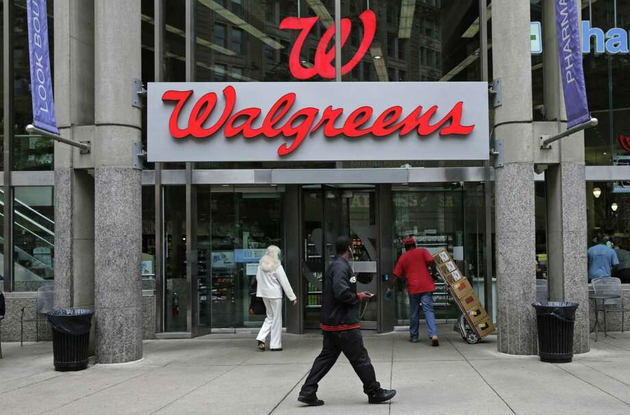Walgreens will let customers pick up and drop off packages shipped through FedEx at thousands of pharmacies. The service initially will be available in a few dozen stores this spring, said Walgreens spokesman Michael Polzin. Photo: Associated Press /File Photo / Copyright 2016 The Associated Press. All rights reserved. This material may not be published, broadcast, rewritten or redistribu