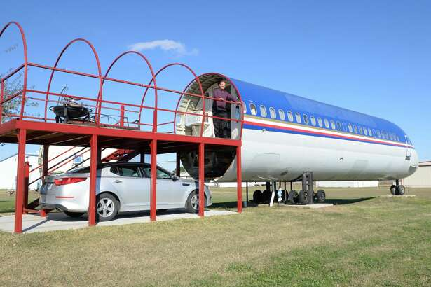 Joe Axline poses on the deck/car port that form the entrance to his home created from a repurposed commercial jet fuselage, Brookshire, TX on January 8, 2017.
