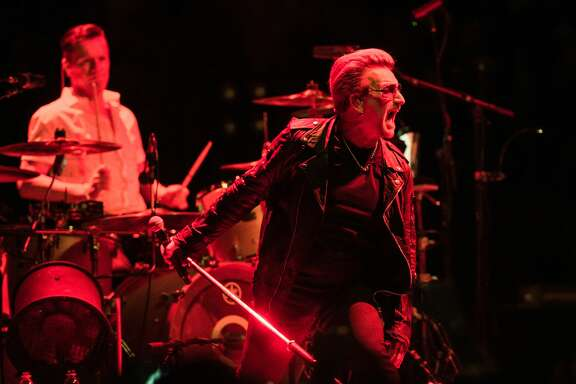 LONDON, ENGLAND - OCTOBER 26:  Larry Mullen Jr. (L) and Bono of U2 perform on October 26, 2015 in London, England.  (Photo by Brian Rasic/WireImage)