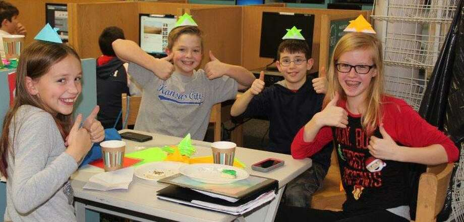 "Students at Schaghticoke Middle School in New Milford recently participated in its annual ""Crane-a-Thon"" project. Above, students, from left to right, Olivia Schulta, Danny Malumphy, Tim Peloso and Gretchen Davis, give a thumbs up as they wrap up crane-making. Photo: Courtesy Of Schaghticoke Middle School / The News-Times Contributed"